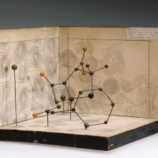Molecular model of Penicillin by Dorothy Hodgkin, c.1945. Front three quarter. Graduated grey background.